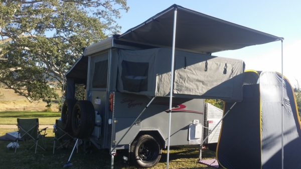 Side on view of the camper fully setup