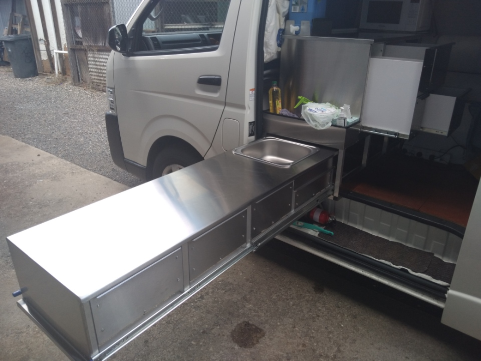 Slide out kitchen storage for van